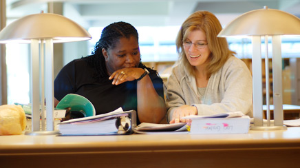 two Portland Community College students studying in the Sylvania Campus Library - courtesy Portland Community College Library, photographer Kristin Beadle